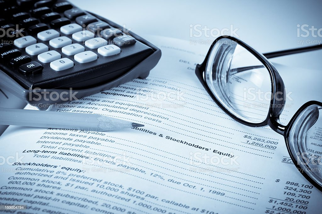 Eye glasses on an accounting book with pencil and calculator royalty-free stock photo