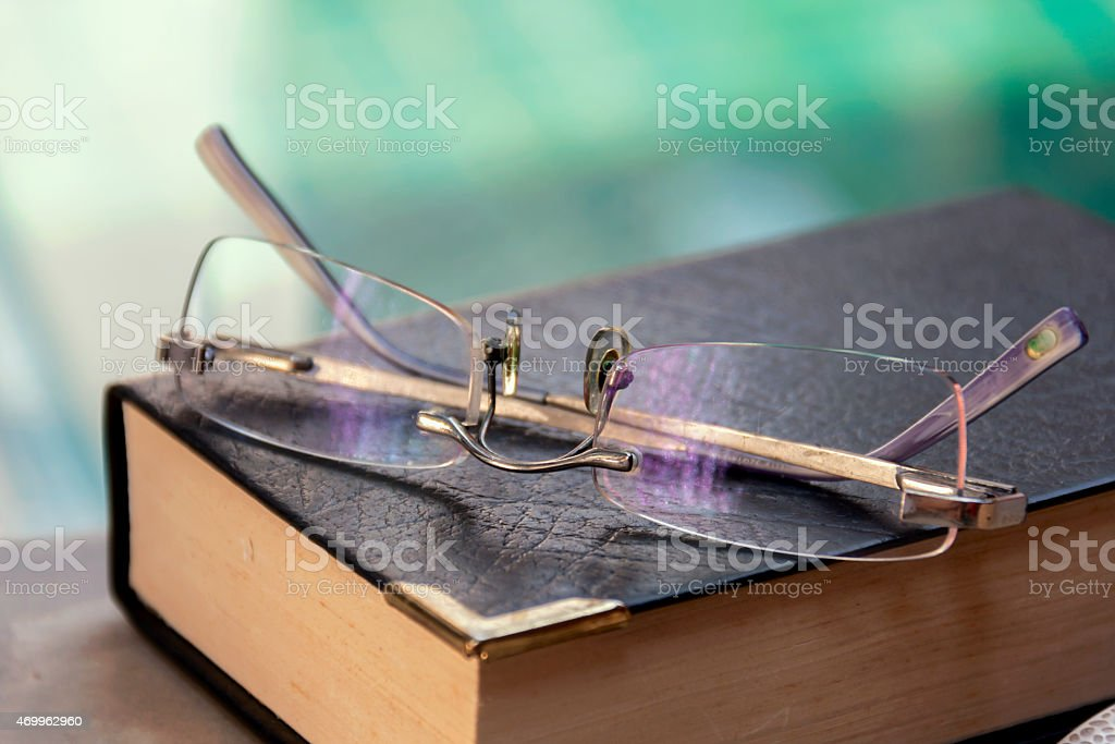 Eye glasses on the book royalty-free stock photo