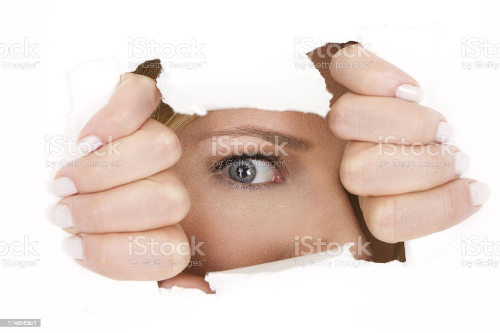 eye looking through white paper royalty-free stock photo