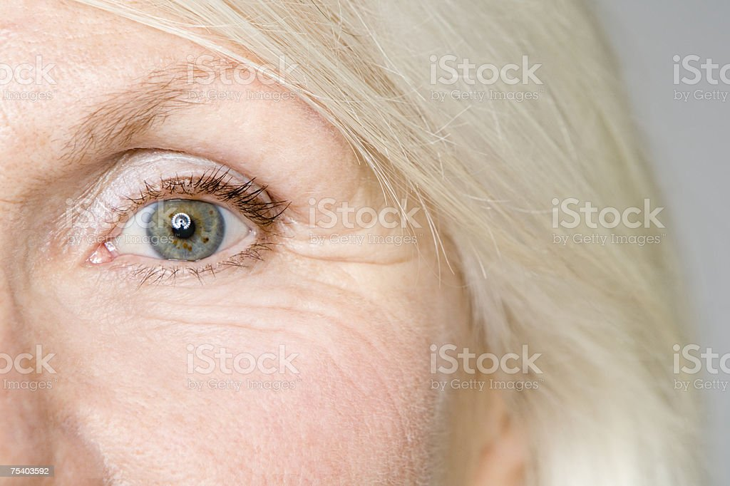 Eye of a senior woman stock photo