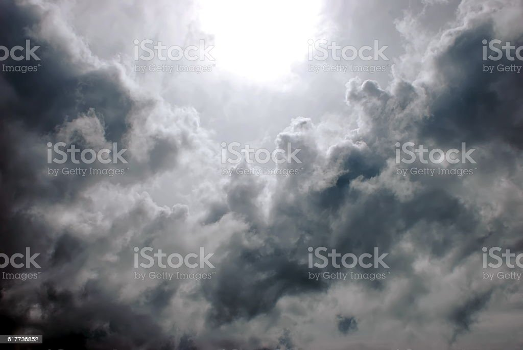 Eye of the Storm, Sunlight shines through Dark Ominous Clouds stock photo