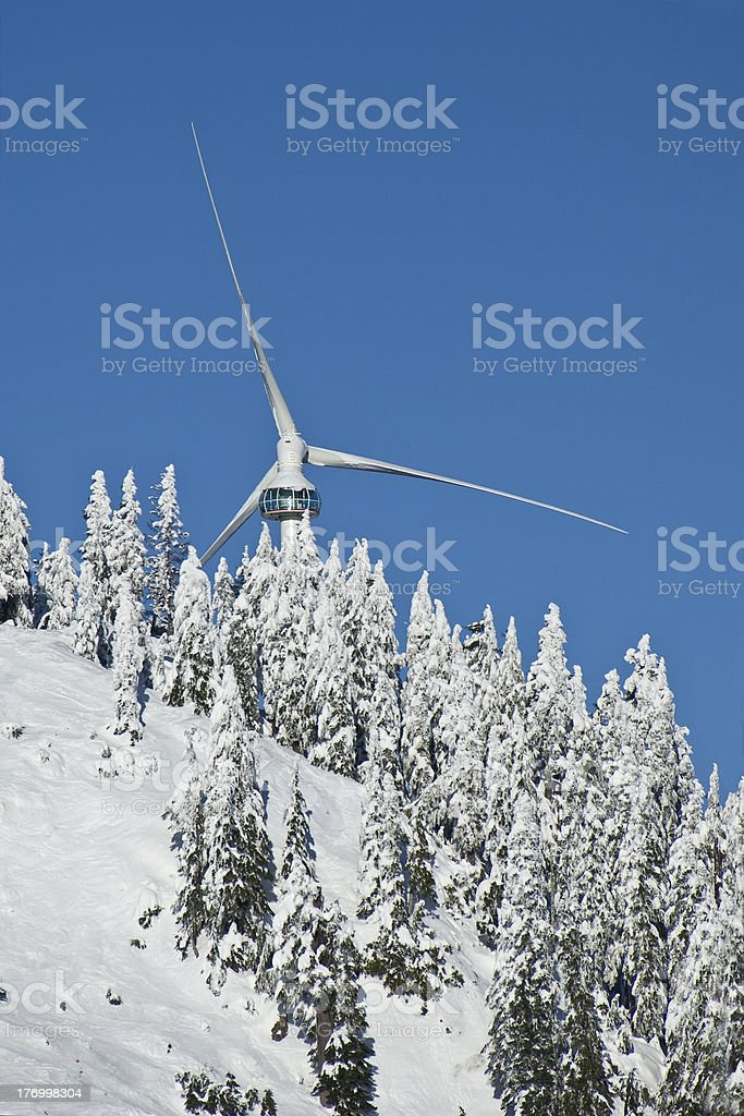 'Eye of the Wind  and snowy evergreens, Grouse Mountain' stock photo