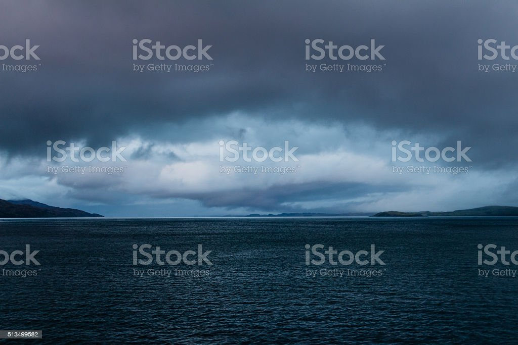 Eye shaped gathering storm at dusk near Mull, Scotland stock photo