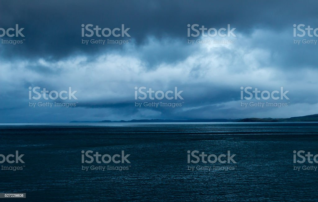Eye shaped storm at dusk near Mull, Scotland stock photo