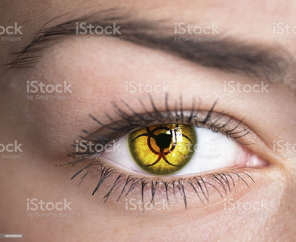 Eye with biohazard symbol. stock photo