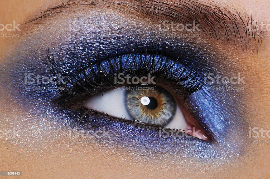 eye with bright blue eyeshadow stock photo