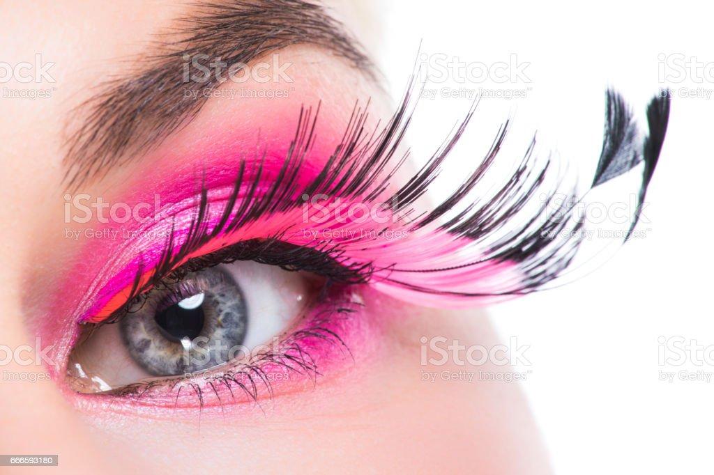 Eye with feather false eyelashes stock photo