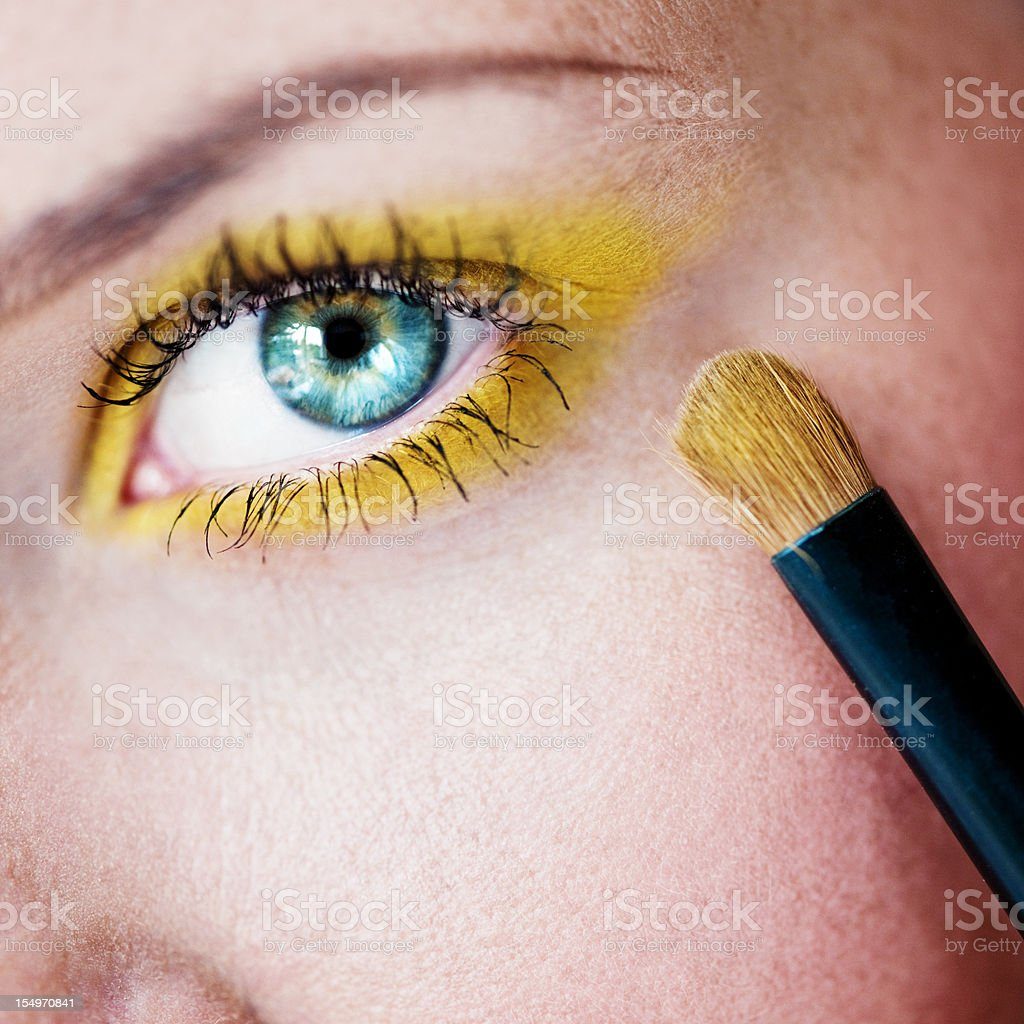 Eye with yellow make-up royalty-free stock photo