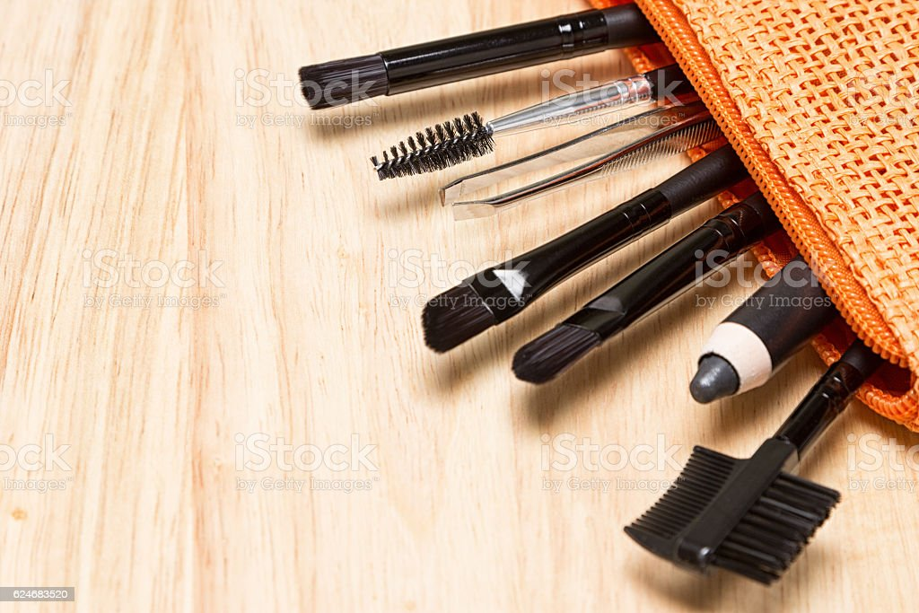 Eyebrow and eyelash grooming tools in cosmetic bag stock photo