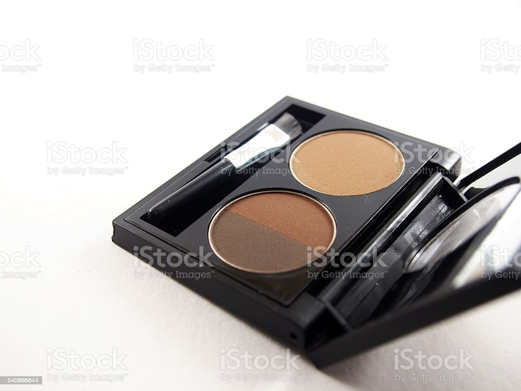 Eyebrow cassette, brown powder with brush stock photo
