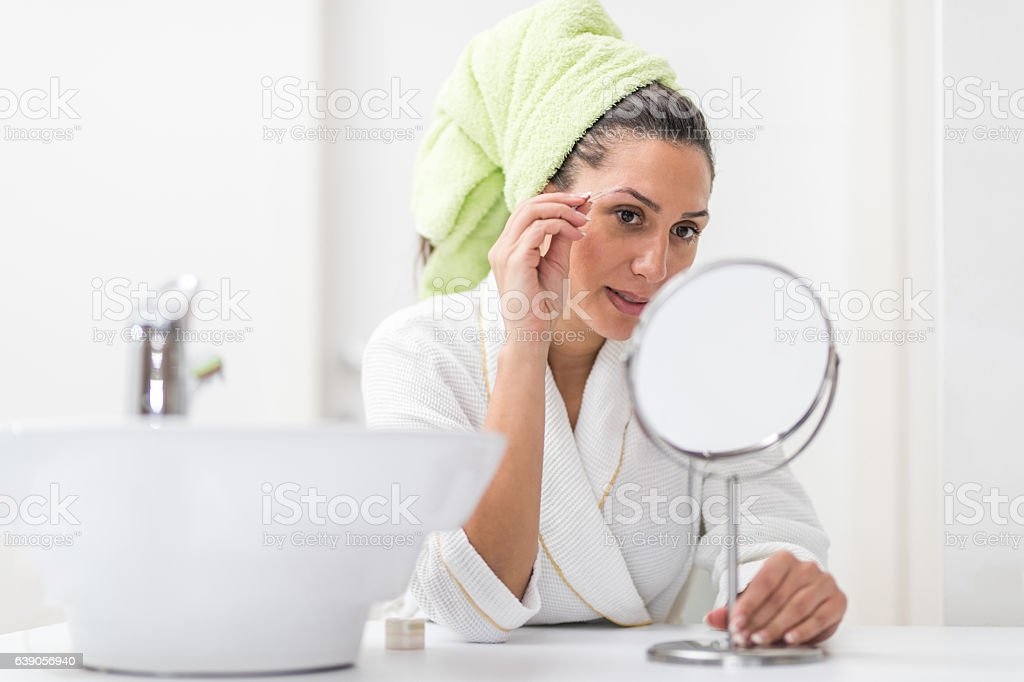 Eyebrow correction stock photo