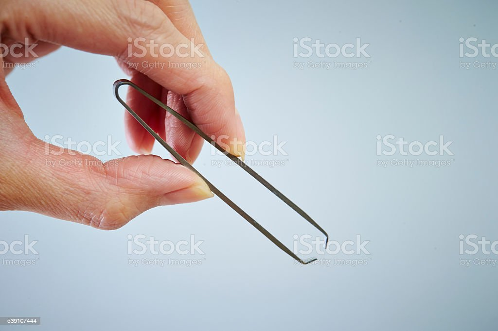Eyebrow tweezers stock photo