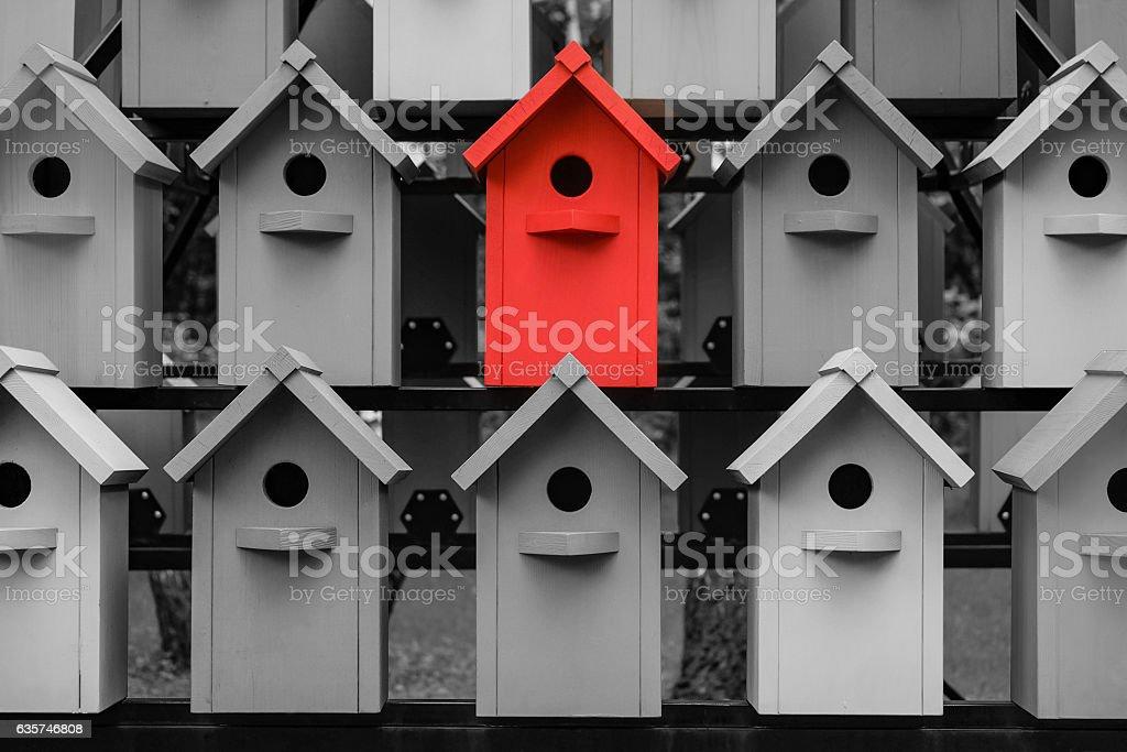 Eye-catching red birdhouse stock photo