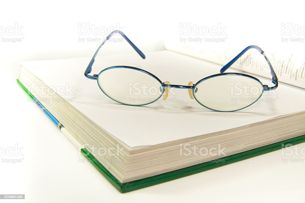 Eyeglass palce on white book royalty-free stock photo
