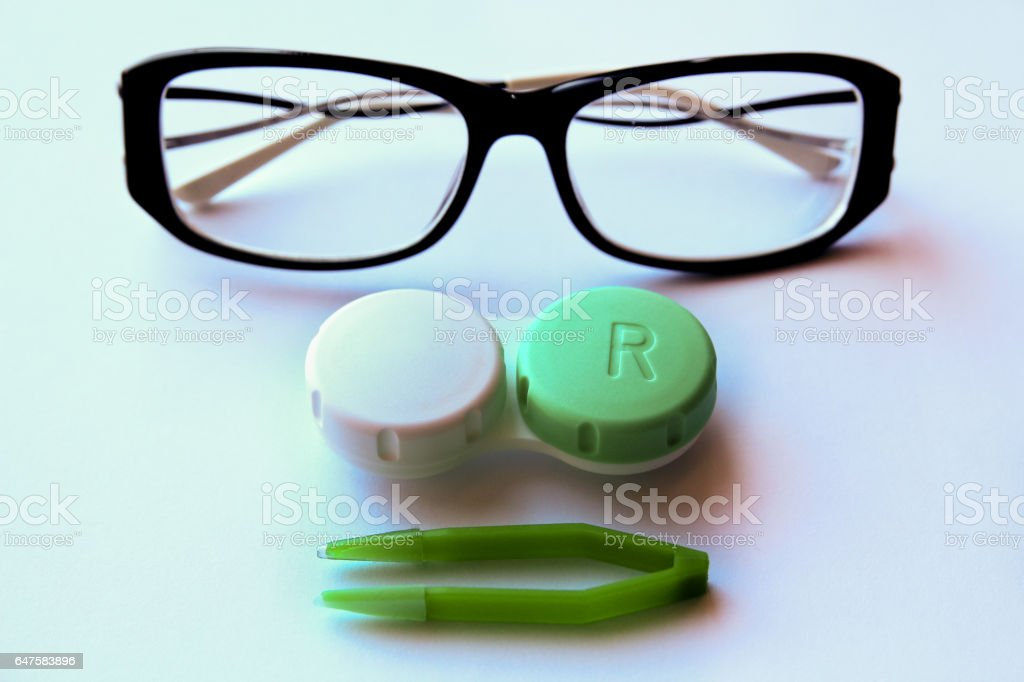 eyeglasses and eye contact lenses on white background. stock photo