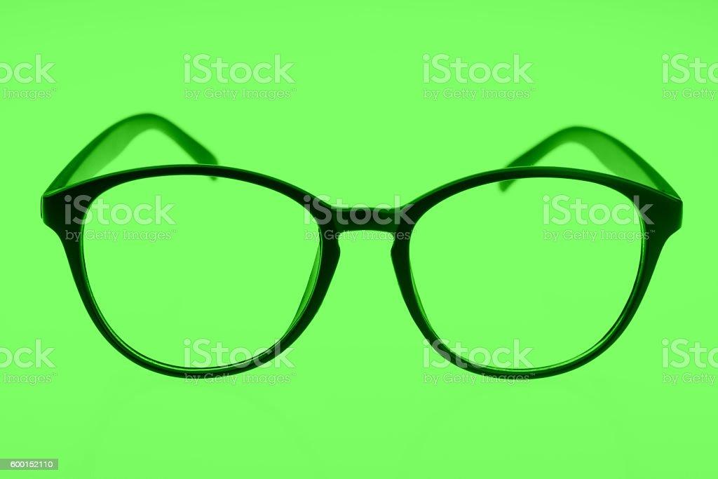 Eyeglasses isolated on green stock photo