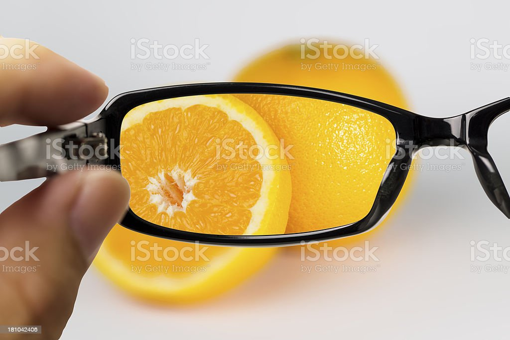 Eyeglasses looking for orange royalty-free stock photo