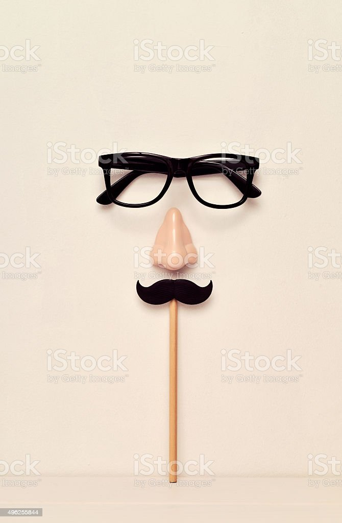 eyeglasses, nose and mustache depicting a man face stock photo