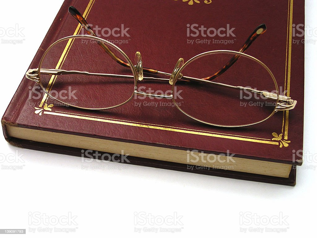 eyeglasses on book stock photo
