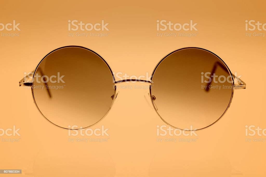 Eyeglasses on brown background stock photo