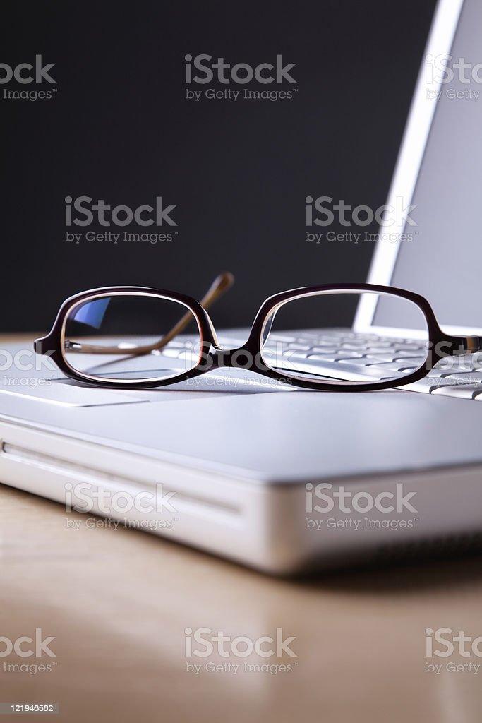 Eyeglasses on laptop royalty-free stock photo