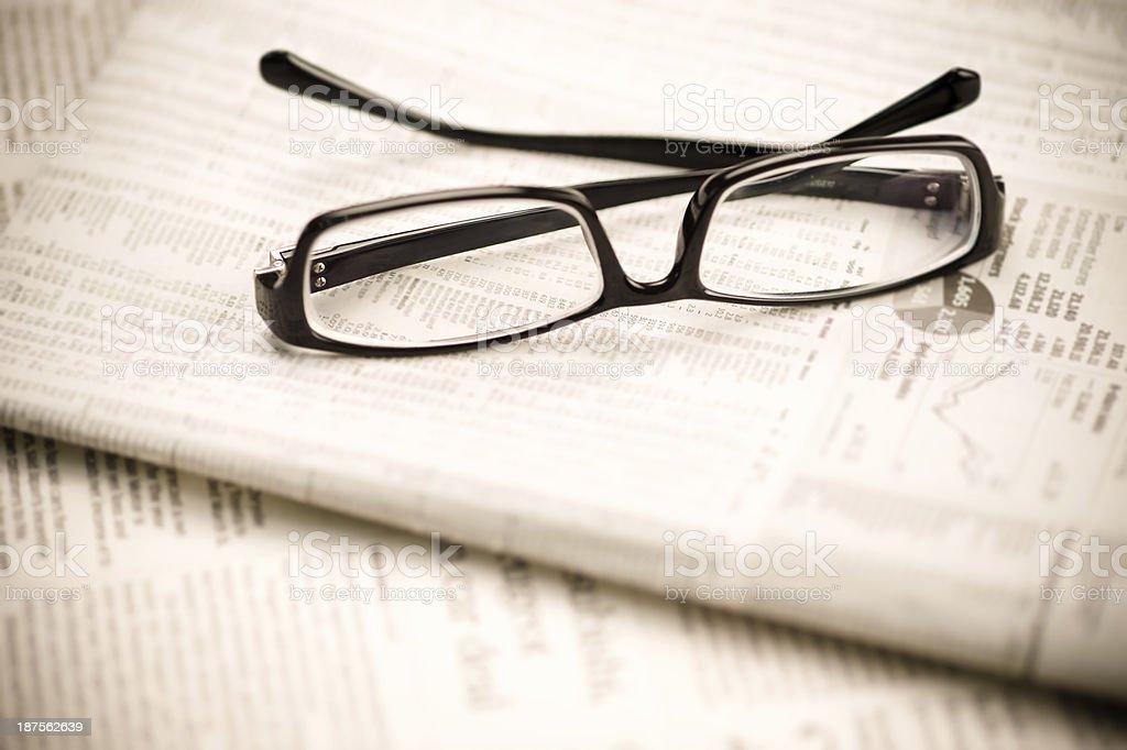 Eyeglasses on Newspaper stock photo