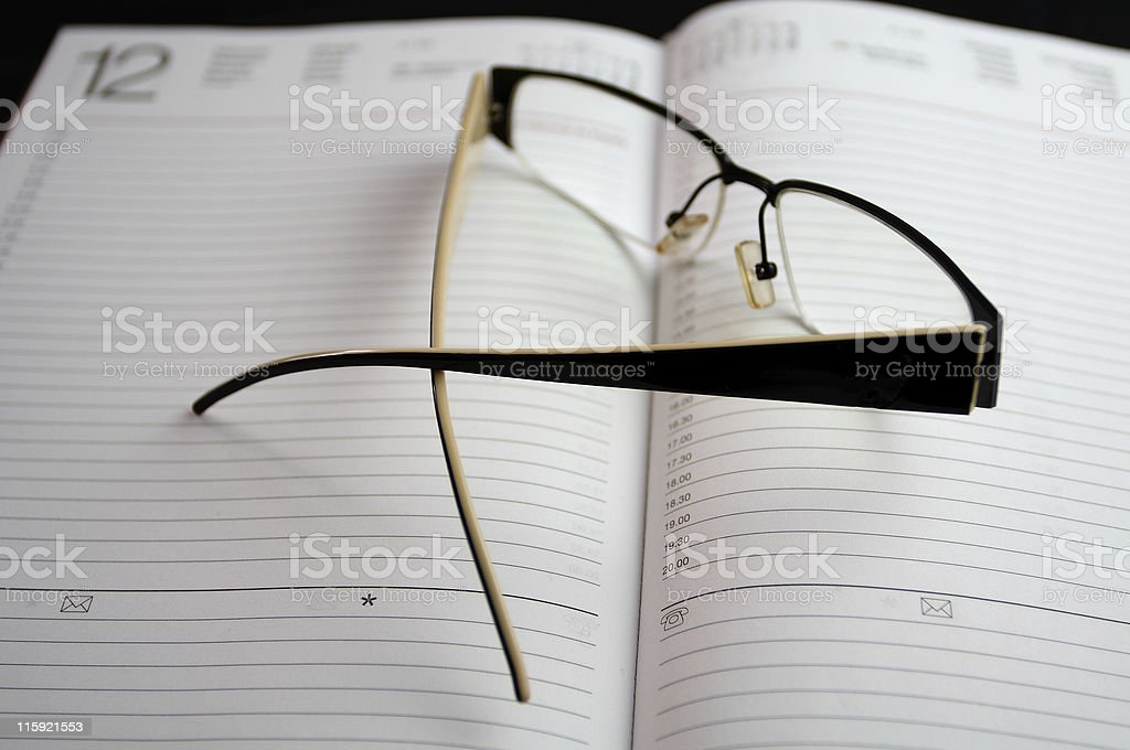 eyeglasses on notebook stock photo