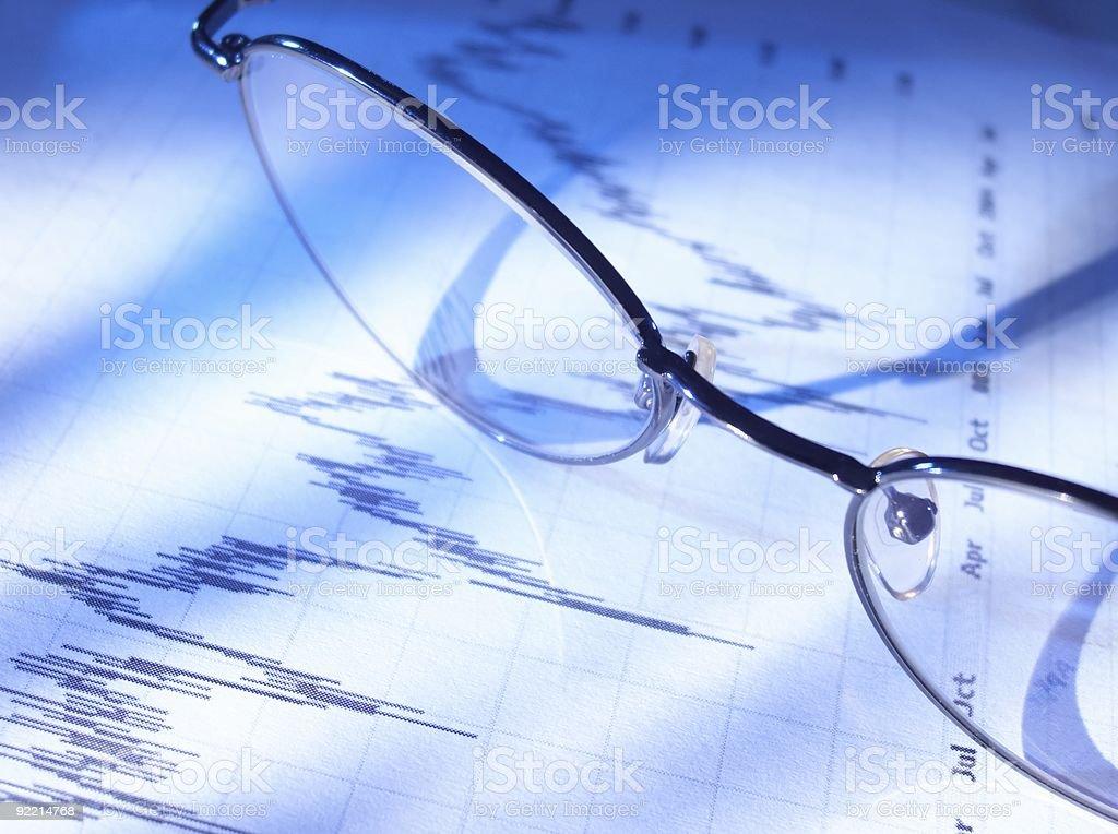 Eyeglasses on stock chart. royalty-free stock photo