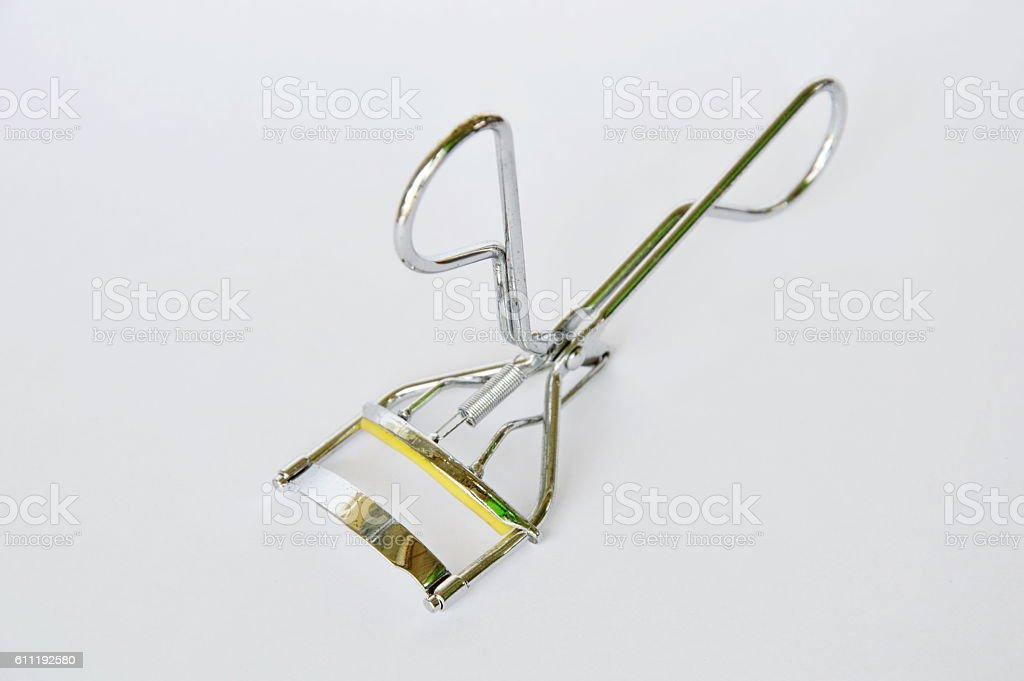 eyelash curler on white background stock photo