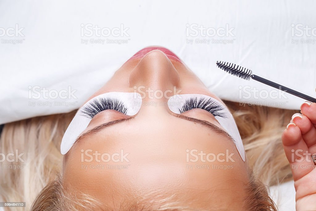 Eyelash Extension Procedure. Woman Eye with Long Eyelashes. Lashes, stock photo