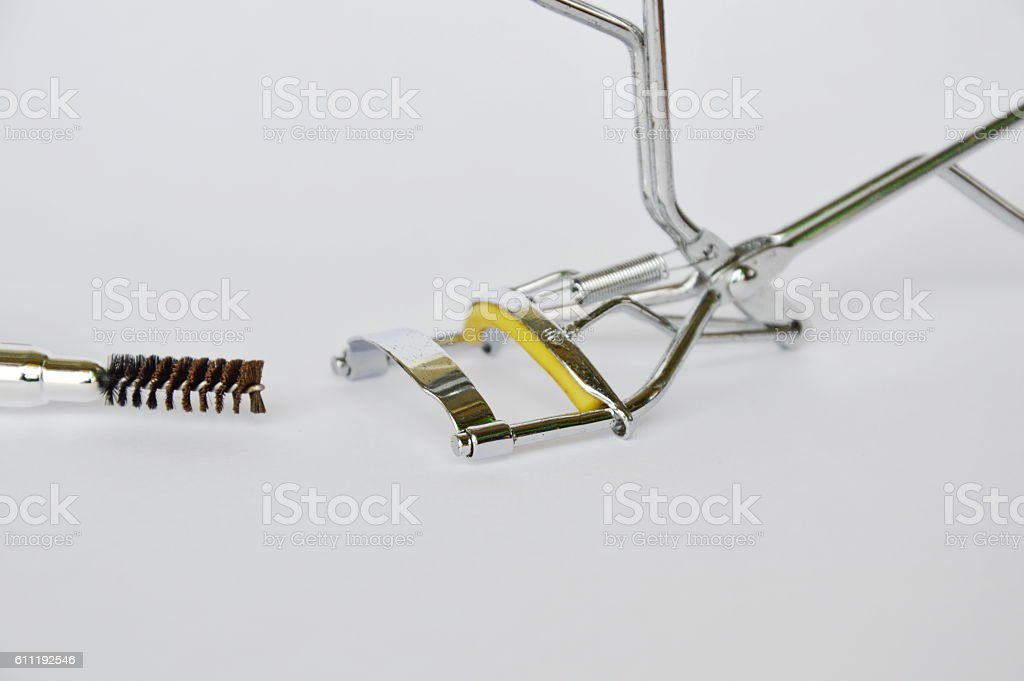 eyelash perm and mascara brush on white background stock photo