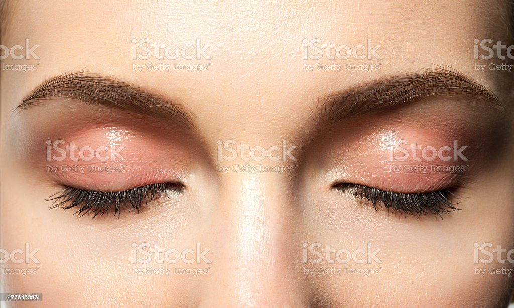 eyes closed with makeup stock photo