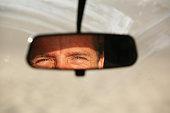 Eyes in a rear view mirror