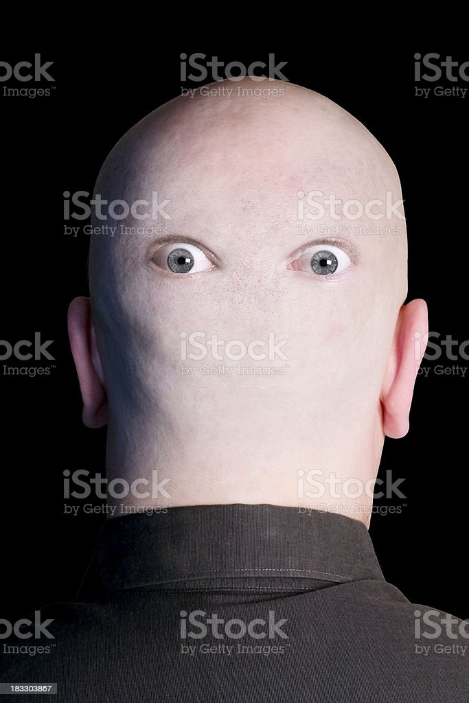 Eyes in the back of my head stock photo