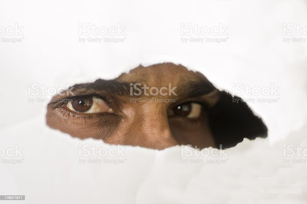 eyes looking at you with suspicion stock photo