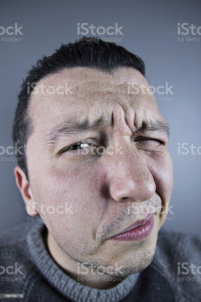 Eyes narrowed people face stock photo