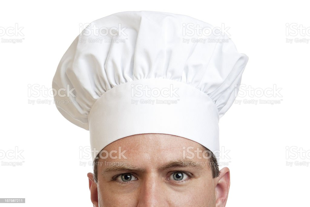 Eyes of a cook with white chef hat royalty-free stock photo