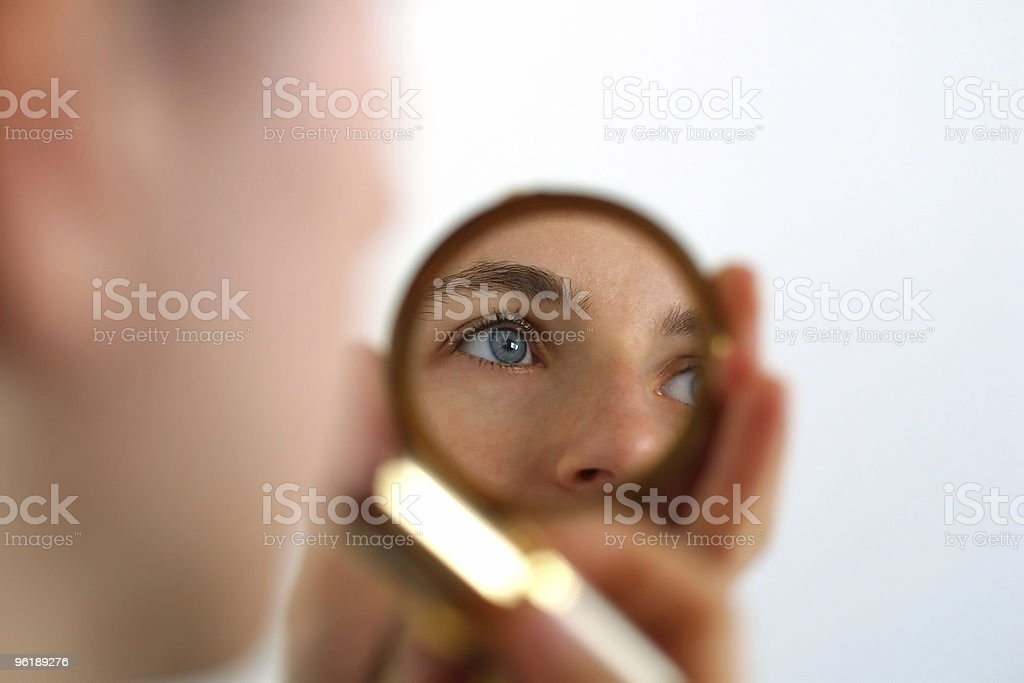 Eyes of a woman reflected in mirror royalty-free stock photo