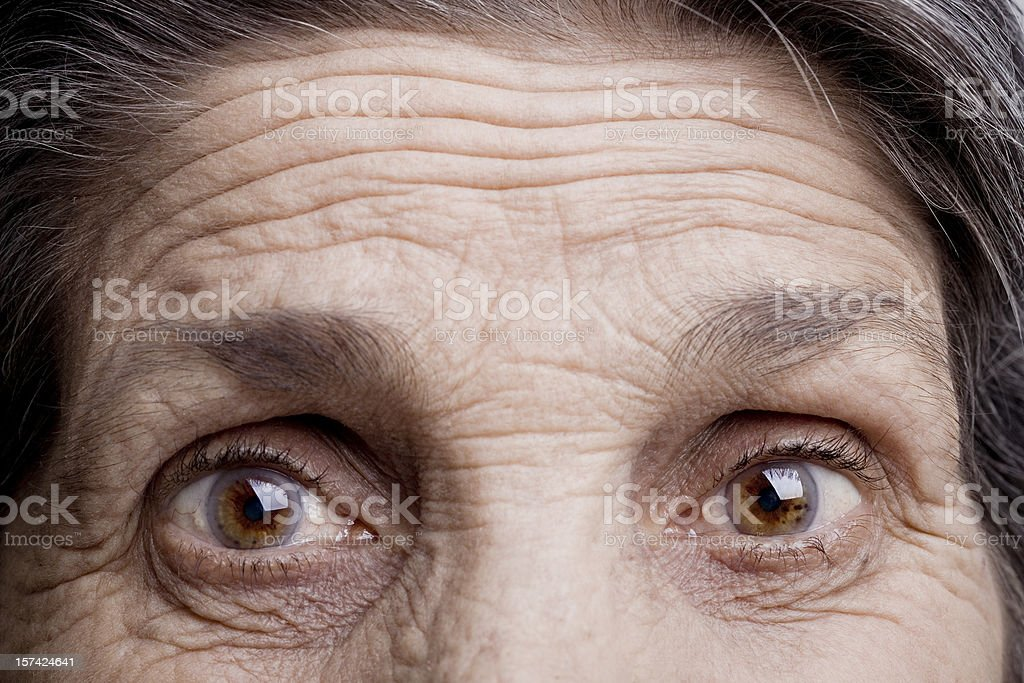 Eyes of an old woman stock photo