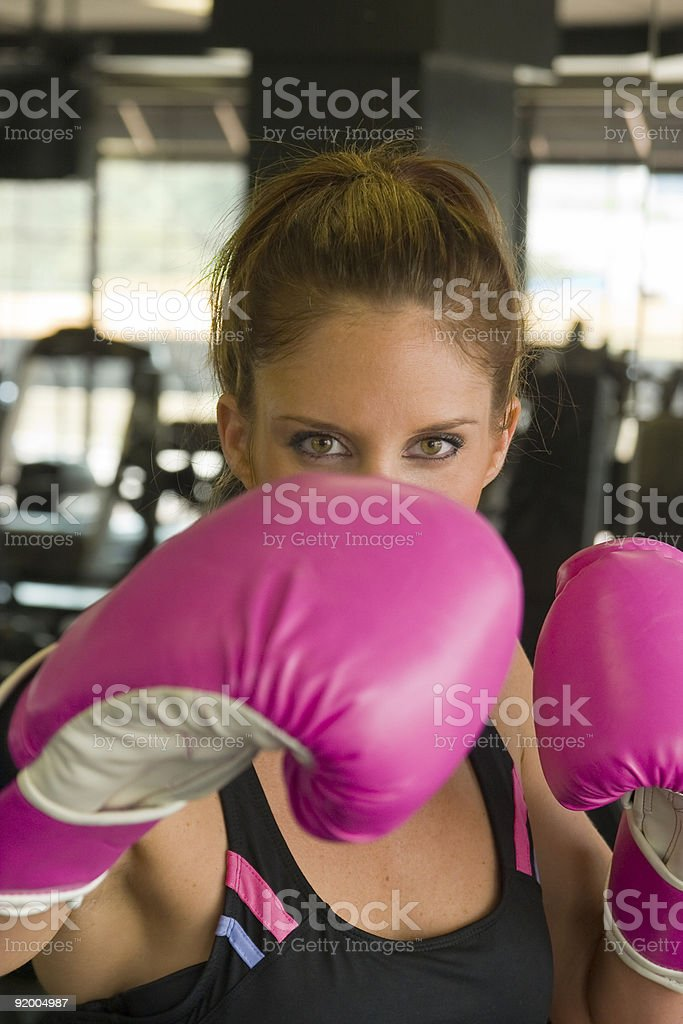 Eyes Of Boxing Woman Above Pink Gloves royalty-free stock photo