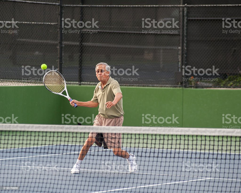 Eyes on the high volley. stock photo