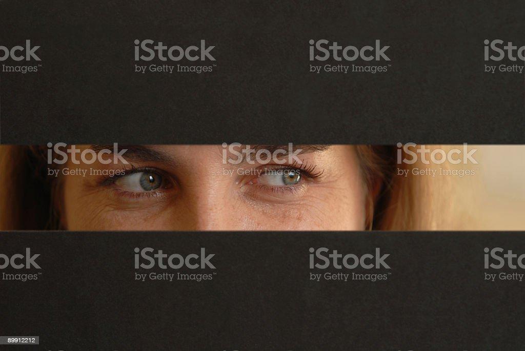 Eyes peeking stock photo
