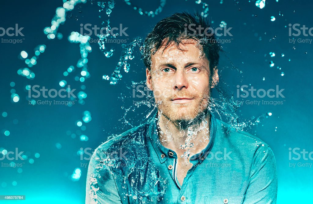 Eyes wide open as man water in his head stock photo