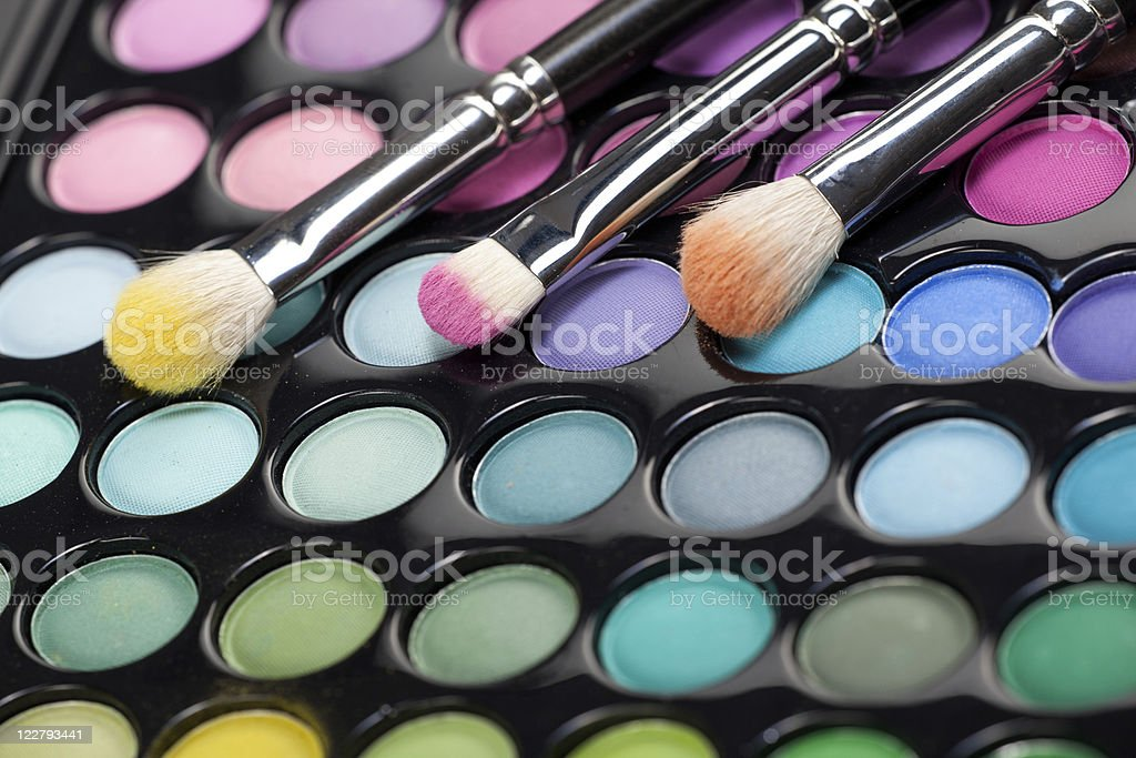 eyeshadow kit with three makeup brushes royalty-free stock photo