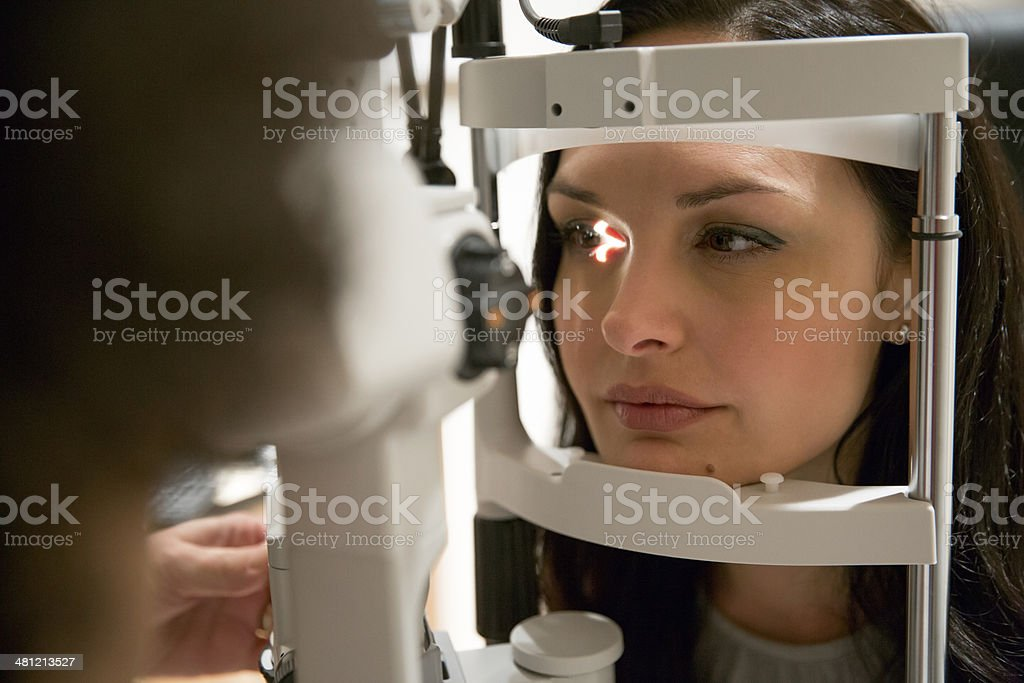 Eyesight exam by optometrist stock photo