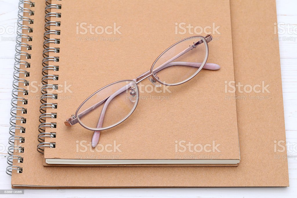 Eyesight glasses and notebook stock photo