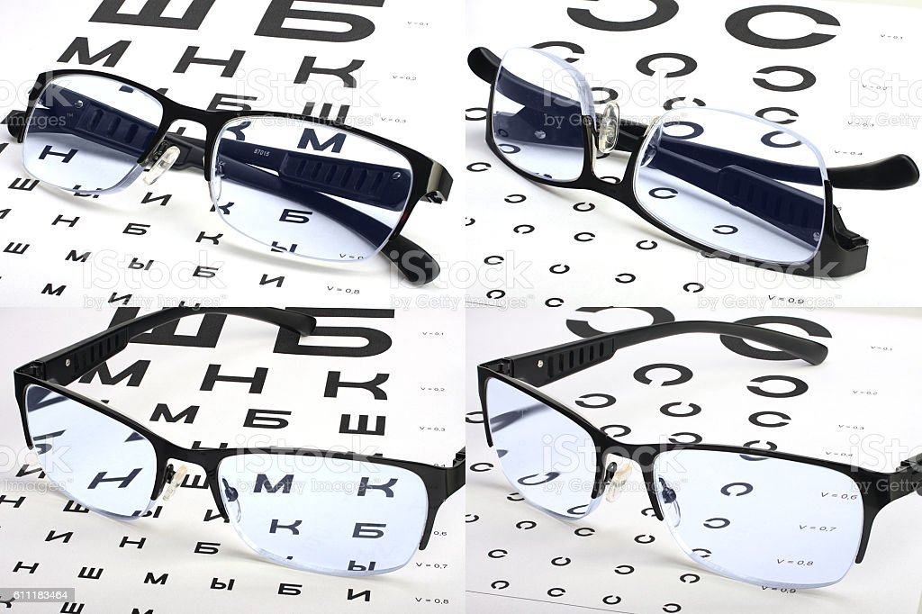 Eyesight test charts and glasses set stock photo