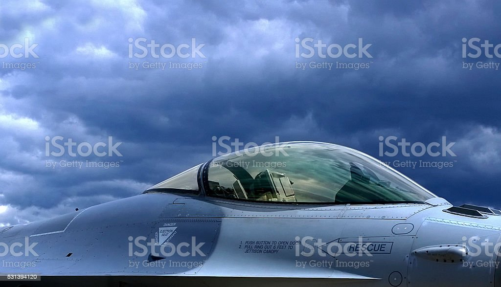 F-16-Fighting Falcon with clouds stock photo