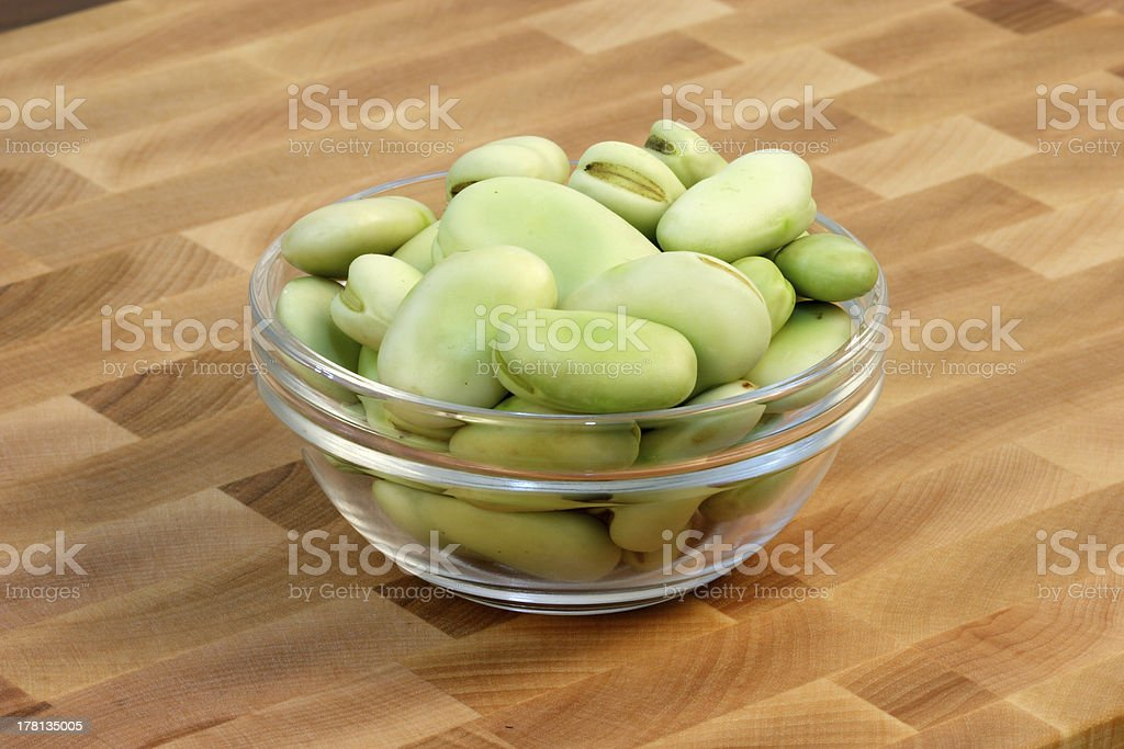 faba  beans  on fine cutting board stock photo
