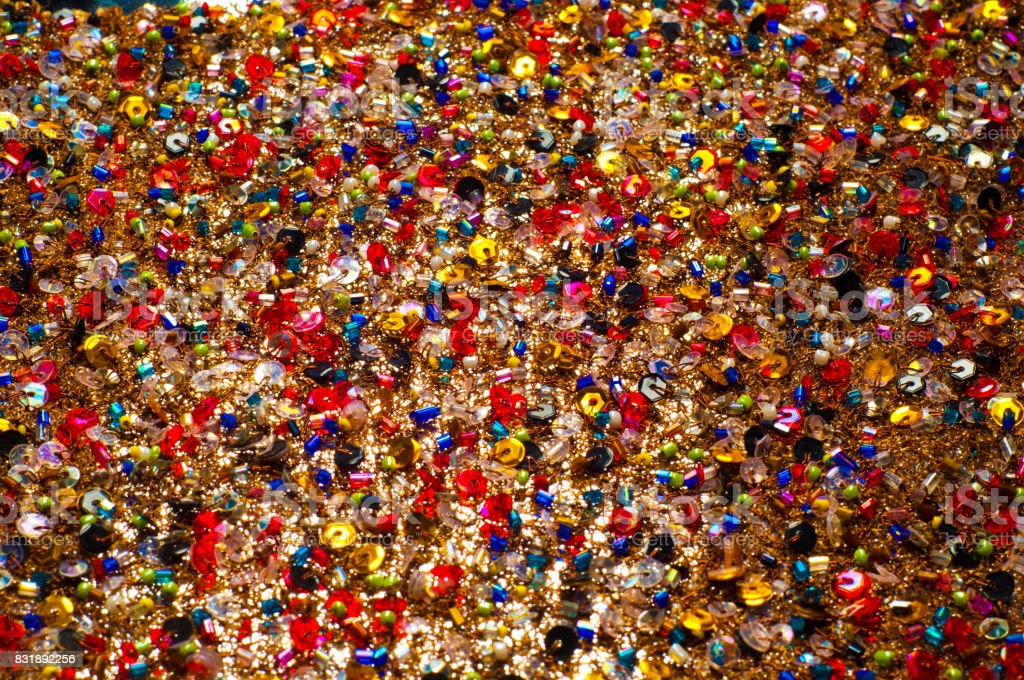 Fabric brown encrusted beads, sequins, beads stock photo